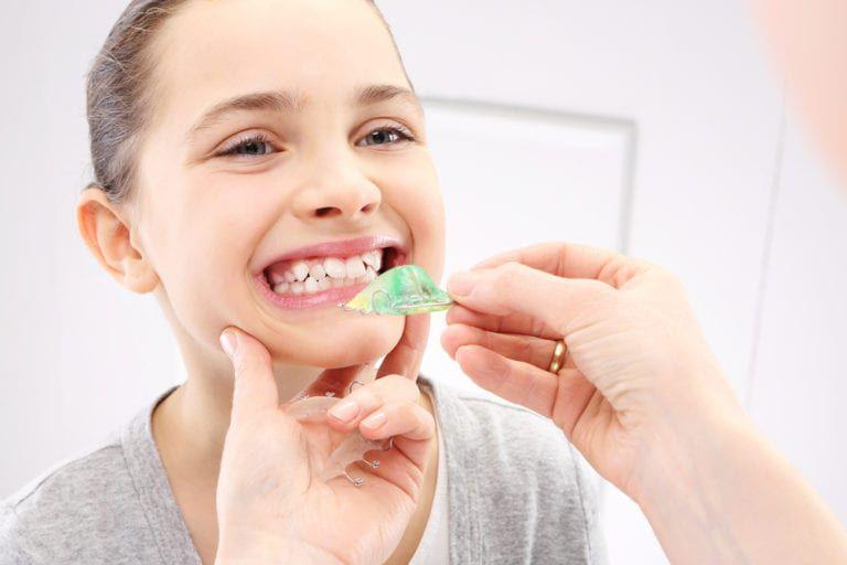 young girl having braces