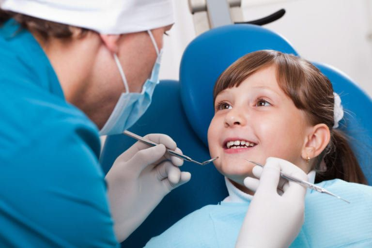 young female child undergoes dental checkup