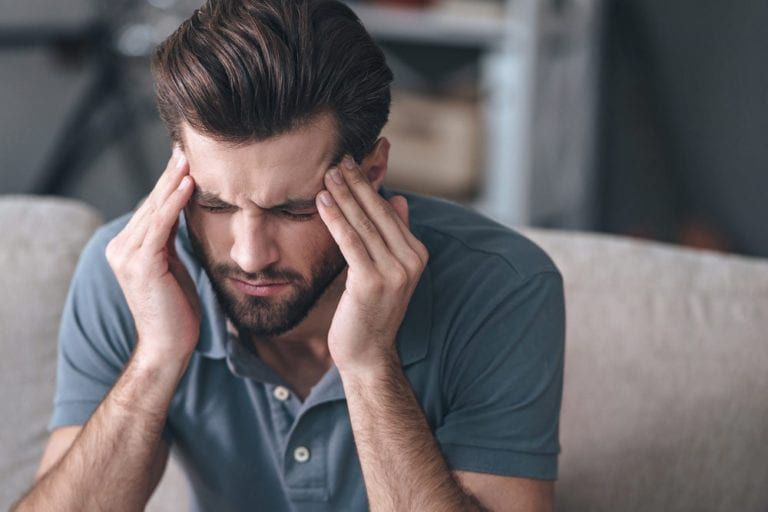 Man feeling pain in head