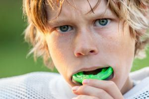 boy wearing mouthguard