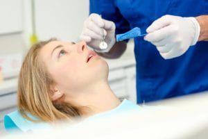 woman having a dental impression taken