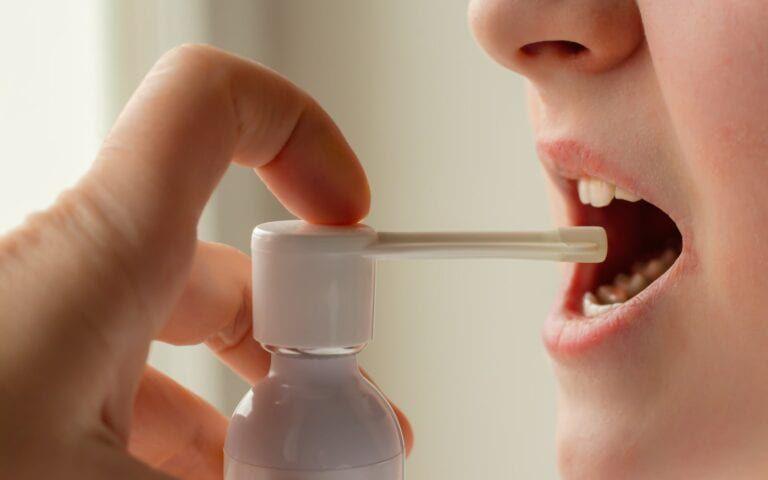 Woman using an asthma spray